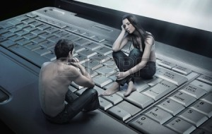9512891-conceptual-photo-of-a-couple-sitting-on-laptop