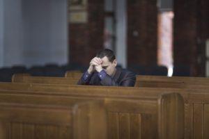 38789205 - man praying in church